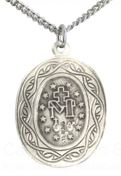 Miraculous medal with crown of thorns border on the back of the pendant is the miraculous symbol and a border of a crown of thorns aloadofball Choice Image