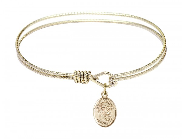 Cable Bangle Bracelet with a Saint Anthony of Padua Charm - Gold