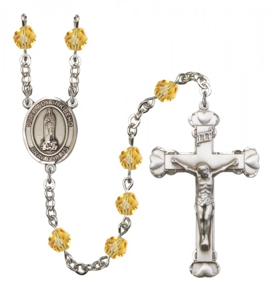 Women's Our Lady of Kibeho Birthstone Rosary - Topaz