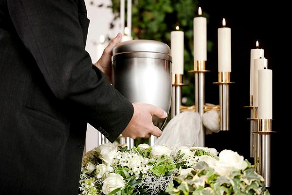 Is it ok for Catholics to be cremated and have their ashes scattered?